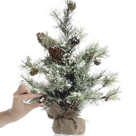 snowy artificial pine tree christmas and holiday