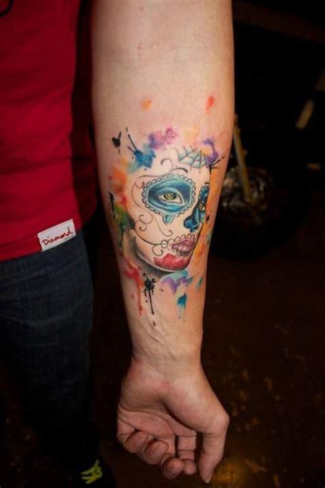 blue eyes watercolor skull tattoo