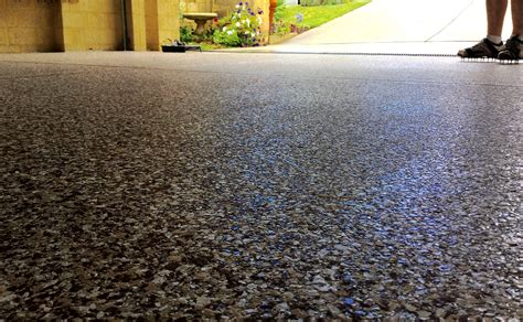 Garage floor epoxy is resistant to moisture, dirt, chemicals, and salts making it ideal for those living in climates where rain and snow are common as the seasons change. Epoxy-Flake-Flooring-in-Ottawa - Garage Perfect