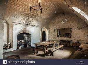 A dining room-kitchen inside a medieval castle Stock Photo