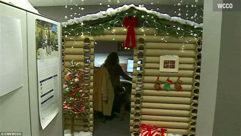 Office Door Christmas Decorating Contest by Saleswoman Transforms Her Desk Space Into A Cozy Log House