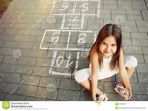 Beautiful Cheerful Little Girl Playing Hopscotch On ...