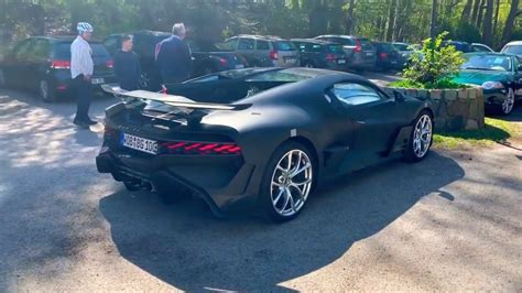 The sheet gradually revealed mat grey bodywork underneath, rippling with sharp angles and gaping inlets. First Bugatti Divo Start Up Sound in Public Road - YouTube