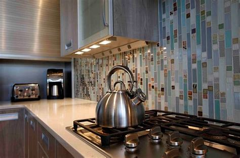 under cabinet lighting with outlets under cabinet lighting adds style and function to your kitchen