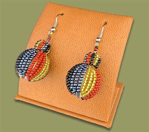 Bobble Earrings earrings bobble bobble earrings brown black gold metallic