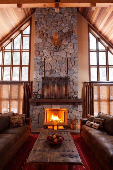 rustic stone fireplace  hidden tv hgtv