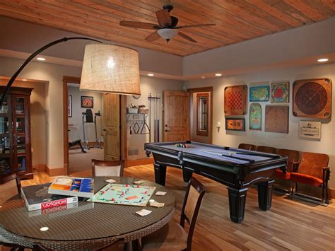basement game room ideas family room traditional with wood paneled ceiling pool table wall art