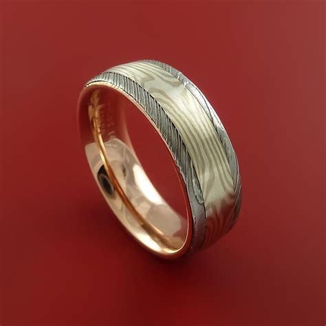 damascus steel  mokume ring  rose gold sleeve