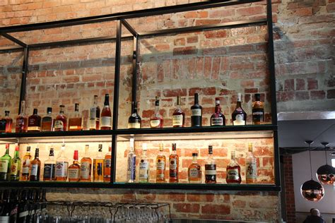 Bar With Shelves by Hotel Bar Wall Shelving In Black Steel Custom Metal