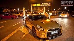 Nissan GTR in Gold in China with a y Girl