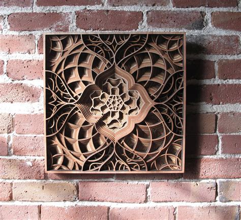 amazingly intricate laser cut wood relief sculptures