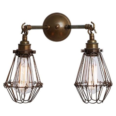 antique brass wall light with twin cage shade create an