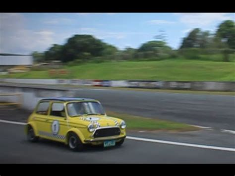 classic mini cooper racing with engine sounds