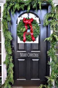 framed christmas wreath on the front door and porch decor