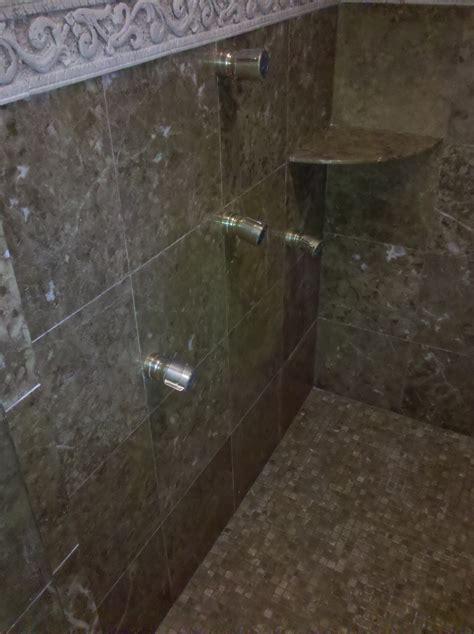 polished emperador brown sudbury marble shower walls