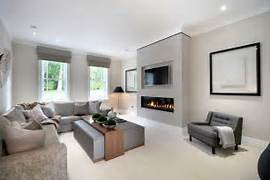 Modern Contemporary Living Rooms by Modern Fireplace With Tv Above Living Room Beach Style With Upholstered Ottom