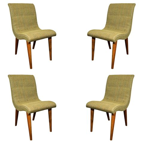 set of four midcentury green upholstered dining chairs by