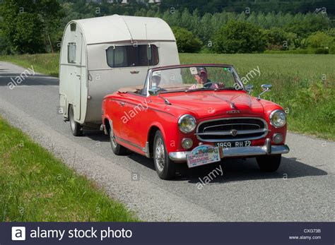 Peugeot 403 Cabriolet by Peugeot 403 Cabriolet And Escargot Caravan Of 1959 In The
