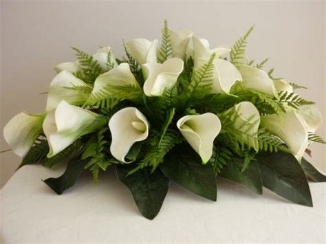 lily arrangements  weddings calla lily bridal table
