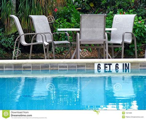 chair and tables by pool royalty free stock images image