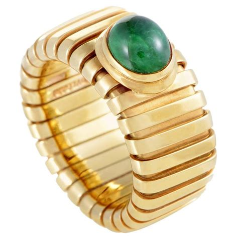 bulgari tubogas yellow gold emerald cabochon band ring at