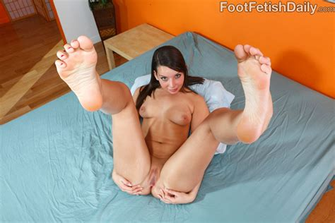 Babe Gives Footjob And Gets Her Toes Covered In Cum