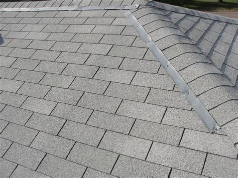 Zinc Strips On A Moss Covered Can I Claim On House Insurance For Leaking Flat Roof How To Install Rooftop Dryer Vent Metal Roofing Center And Supply Foley Alabama Modern Materials Uk Bitumen Installation Seal Rv Felt Cap Sheet Cleaning Houston Texas