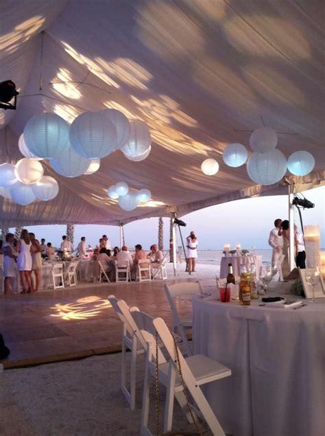 white tent liner white wedding paper lanterns beach