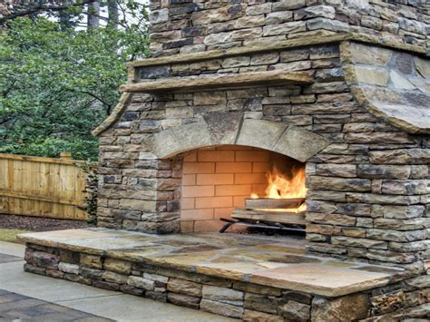 Laying a paver patio, stacked stone outdoor fireplace