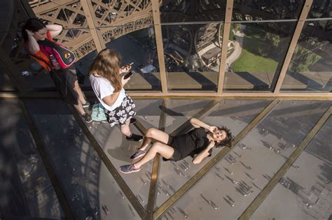 The Eiffel Tower Has A Scary New Glass Floor And Selfie