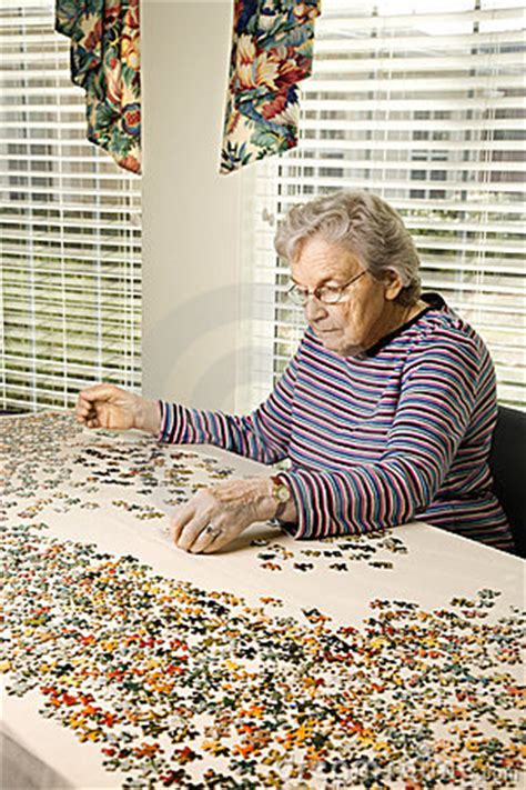 jigsaw puzzles  seniors elderly woman solving