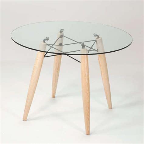Table ronde design en verre transparent et structure bois