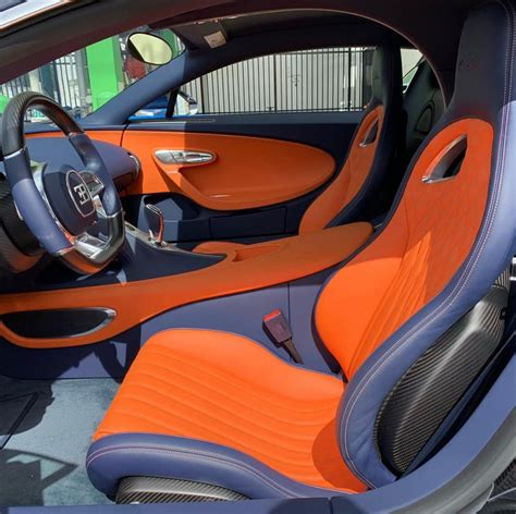 Bugatti chiron 8.0 liter quad turbocharged w16 engine, 1500 horsepower top speed is limited to 420 km/h aed 15 million only 500 made. Interior of the Bugatti Chiron painted in French Blue w ...