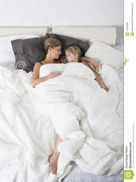 mother  daughter sleeping  high angle view stock