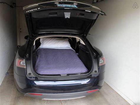 tesla trunk airbnb sleep night spent science