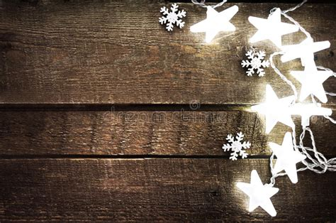 Christmas Rustic Background With Lights, Snowflakes, Stars