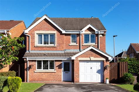 What Does Detached House - detached house with garage stock editorial photo
