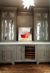 gorgeous built  bar  gray upper cabinets accented