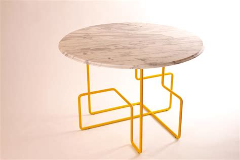 yellow table l base kst dining table by livius härer and ada ihmels design milk