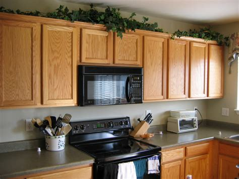 above kitchen cabinets ideas tips decorating above kitchen cabinets my kitchen interior mykitcheninterior