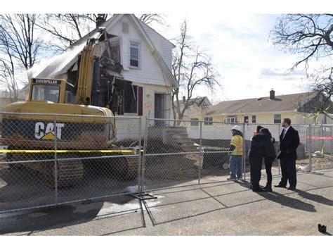 crews demolish woodbridge home damaged  superstorm sandy