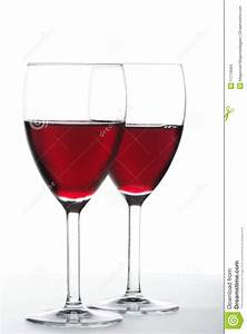 Two glasses of red wine stock photo. Image of drops, drink ...