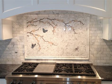 calacatta gold mosaic backsplash transitional kitchen