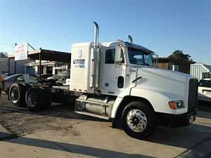 Kenworth W900l  1999    Daycab Semi Trucks