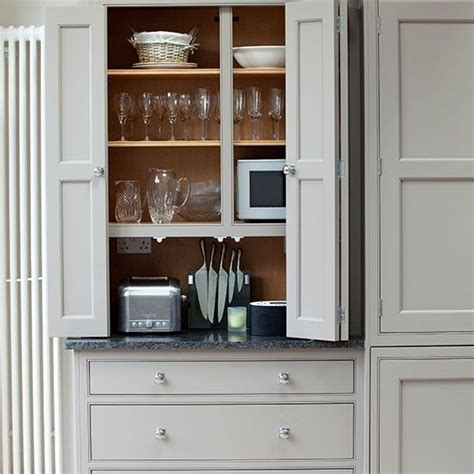 bifold kitchen cabinet doors pale grey kitchen with fitted storage grey toaster and 4620
