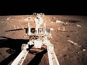 "China's moon rover Yutu (""Jade Rabbit"") rolls down a ramp ..."