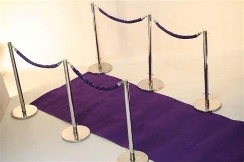 small purple vip carpet walkway with chrome stanchions