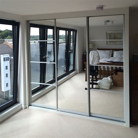mirrored wardrobes bring light  space   bedroom