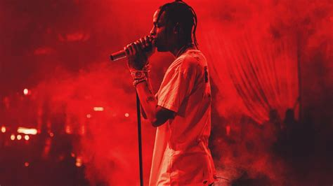 travis scott  red background wearing white  shirt