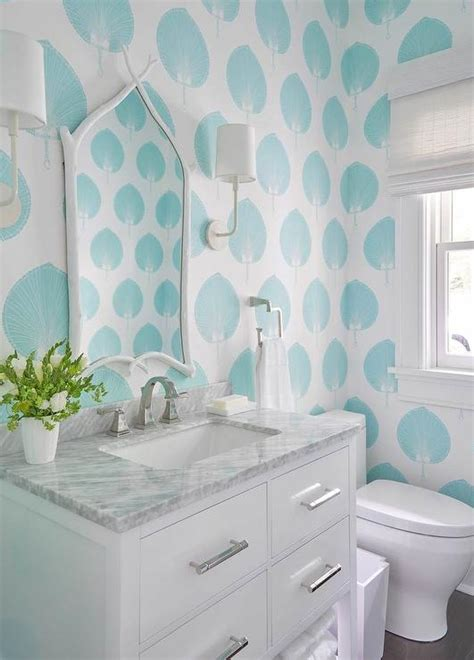 aqua blue powder room  white faux bois mirror
